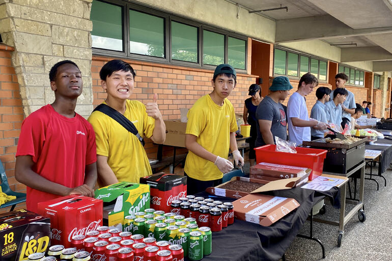 Dilworth School prefects sell food and drinks to fundraise at the House to House event.