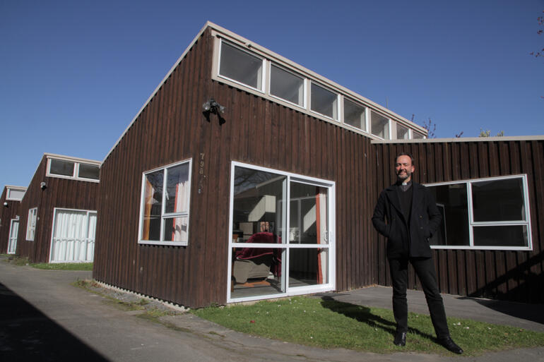 Vicar of Dunedin North Rev Canon Michael Wallace stands outside the three flats the parish has shifted into social housing.