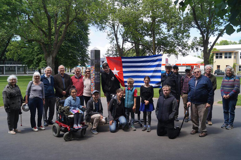 Dr George Davis stands with West Papua human rights supporters in Dunedin on Morning Star Day, 1 December 2018.