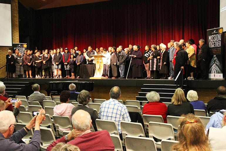 "The Tikanga Maori conference-goers gathered on stage during Tuesday evening's Tikanga Maori ""mission celebration."""