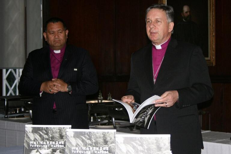 Archbishop David Moxon commends the new book to his audience - while Bishop Kito Pikaahu looks on.