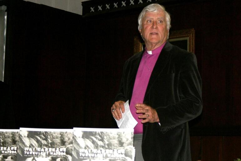 Bishop John Bluck, the author of Wai Karekare - Turbulent Waters, speaking at the book's launch.