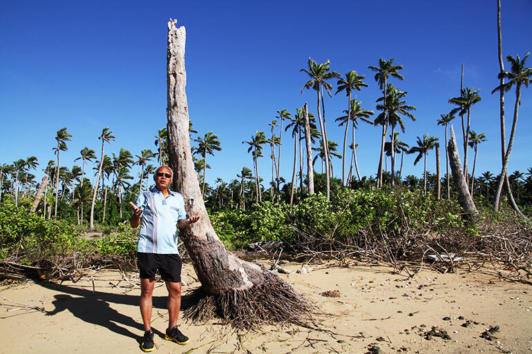 Archbishop Winston Halapua at Pangaimotu Island, in Tonga. He fished here as a boy - and now sees the island slowly dying from rising salt water.