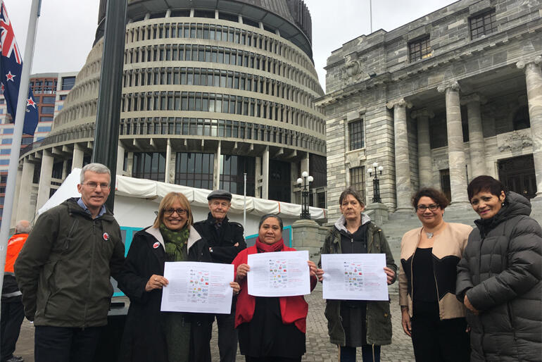 Representatives from the Equality Network present the three goals to MPs on the steps of Parliament today.