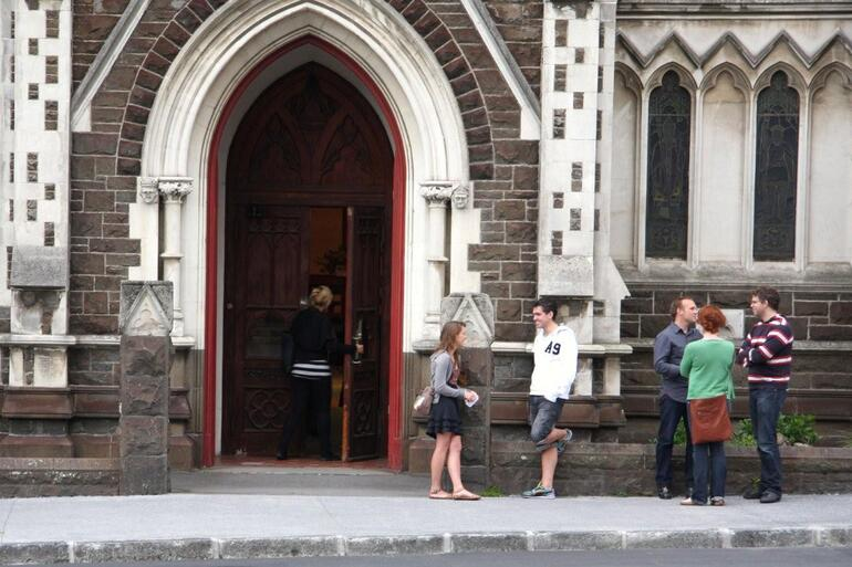 Mathew Newton (blue shirt) catches up with folk arriving for the 6.30pm Sunday service at St Paul's Symonds St.