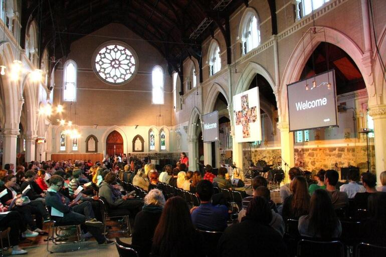 Young folk file into the 6.30pm Sunday service at St Paul's Symonds St.