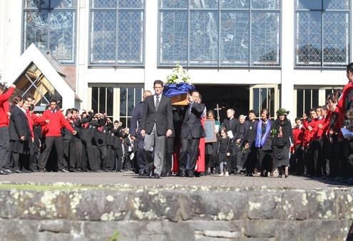 Sir Paul is borne shoulder high to the waiting hearse as hundreds of school kids perform a haka.