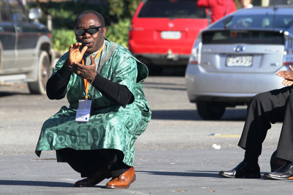 Archbishop Ben Kwashi responds to the powhiri. In Nigeria, he explained, visitors show their respect by kneeling.