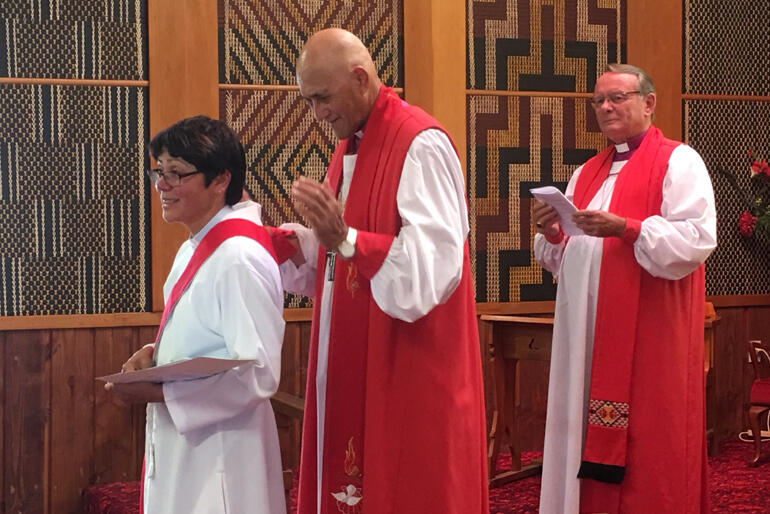 Newly deaconed Brigitte Te Awe Awe Bevan lines up with Bishop Muru Walters and Archbishop Emeritus John Paterson.