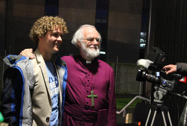 Archbishop Rowan with Sam Johnson, the young inspiration behind the volunteers' rock concert in Christchurch.