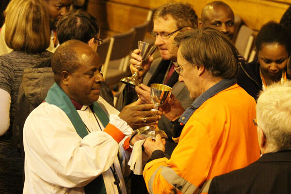 Bishop James Ligo of Vanuatu serves the chalice during the final conference Eucharist.