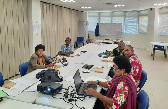 Fijian translators meet to work on further Prayer Book texts projected on screen at the Moana Anglican Services and Teaching Centre in Suva, 2020.