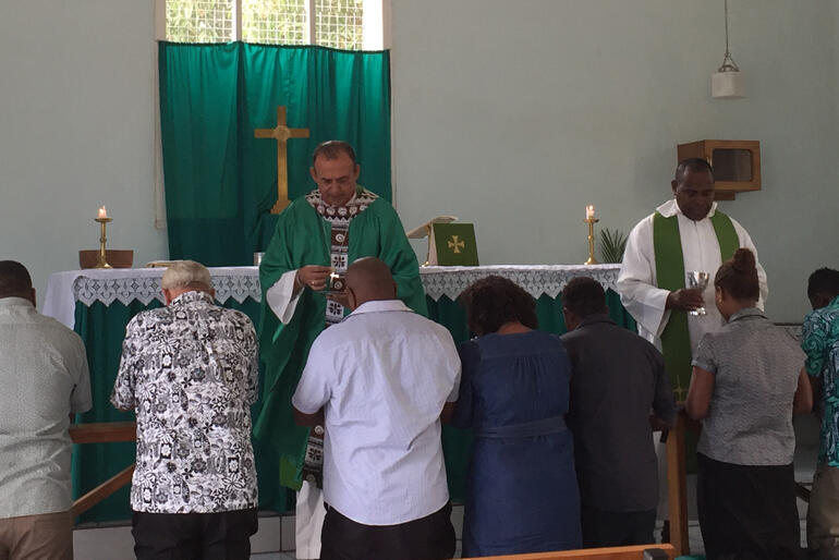 Bishop Gabriel Sharma and Rev Jioji Abonio serve holy communion at St Christopher's in Nadi, Fiji.