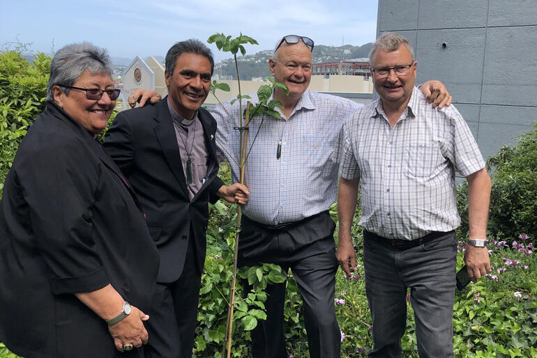 Bishop Waitohiariki Quayle and Canon Robert Kereopa join David and Grant Hadfield to plant a centenary celebration tree.