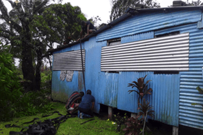 Diocese of Polynesia volunteers secure storm shutters. Donations to Anglican Missions' Cyclone Yasa appeal will aid recovery in Vanua Levu.