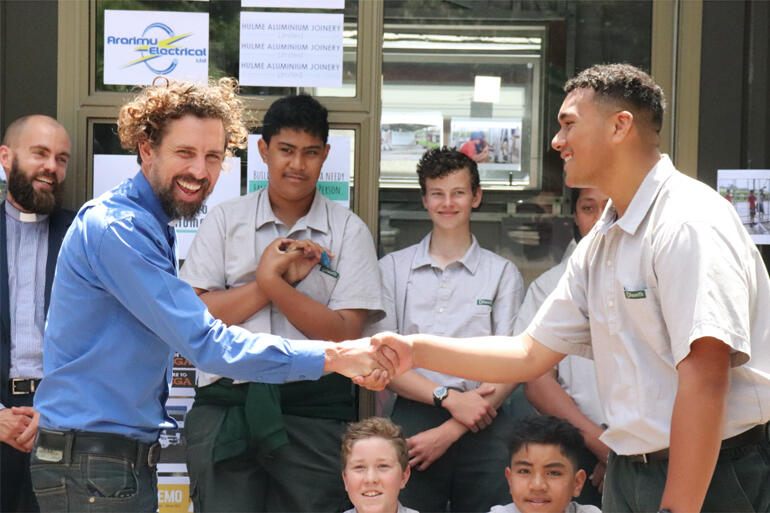 Rev Joel Carpenter and Dilworth student Josh Futi shake hands on the sleepout he and his Year 9 classmates built for a local family in need.