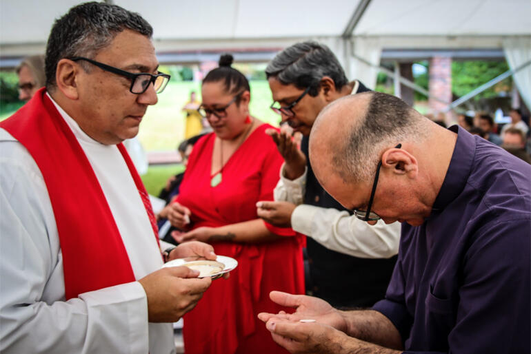 Principal Rev Katene Eruera serves communion to Tikanga Māori Acting Dean, Rev Dr Paul Reynolds at Tuesday's St John's College opening.