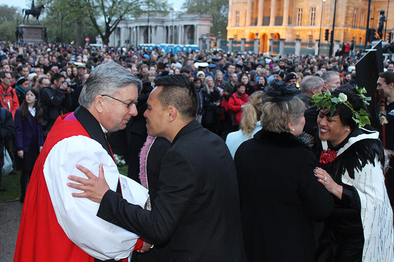 Archbishop Sir David Moxon hongis members of Ngati Ranana after the dawn service in Hyde Park.