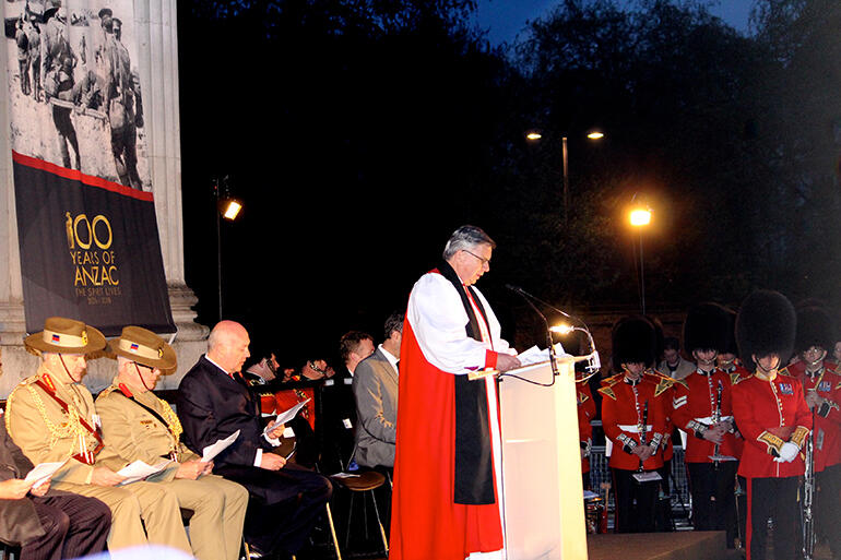 Archbishop Sir David Moxon leading the dawn service before The Wellington Arch in Hyde Park.