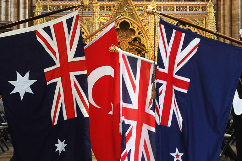 The flags of New Zealand, Turkey, Australia and the United Kingdom dipped in honour of the fallen in Westminster Abbey.