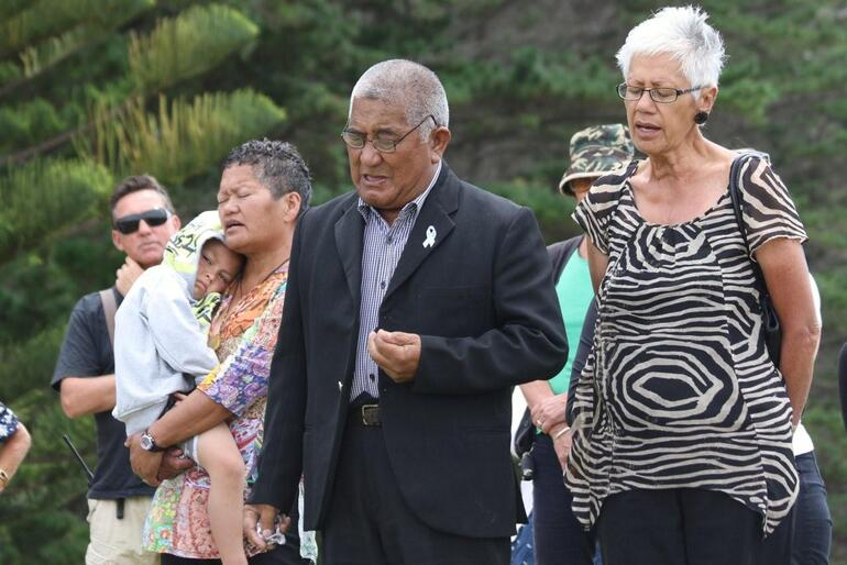 Charlie Rihari, the whanau minita, committed the project to God's care. That's his wife Sue beside him, helping with a waiata.