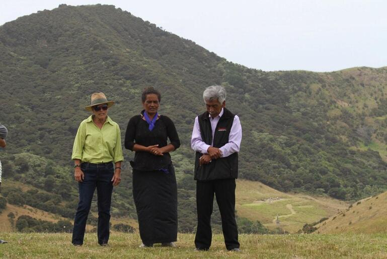 Raewyn Rihari and Raewyn and Hugh's daughter Kiri supply a waiata after Hugh's whaikorero. Note the Marsden Cross in the distance.