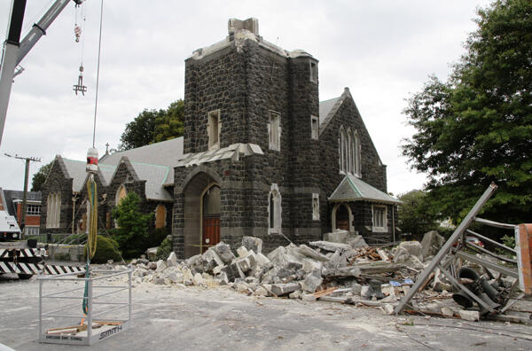 St Mary's in Merivale, minus half its tower. The adjacent brick vicarage is due for complete demolition. Photo: Lloyd Ashton