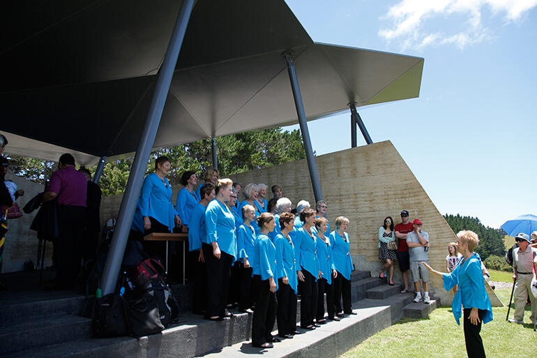 A choir sings carols in Rore Kahu, the Rangihou Heritage Park interpretive centre.