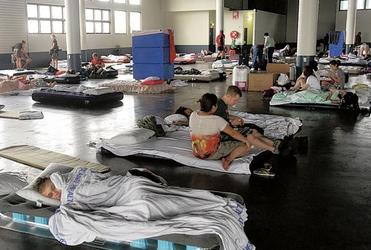 Flood victims doss down in a Brisbane evacuation centre.