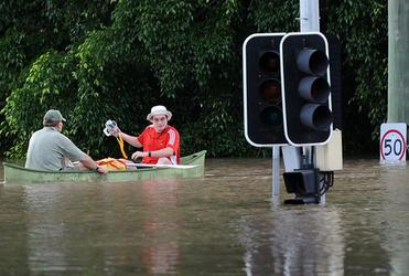 Navigating a flooded street in Brisbane.