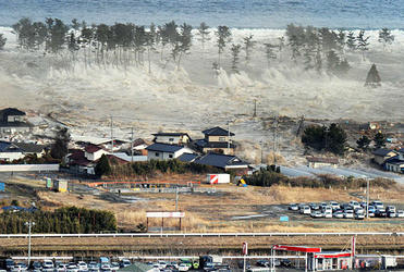 The tsunami hits Natori in Miyagi prefecture. Photo: Reuters