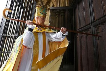 Archbishop Welby strikes three times on the West Door of Canterbury Cathedral. Photo: Daily Telegraph