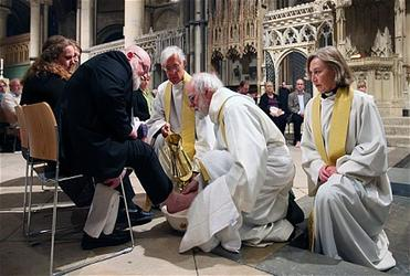Dr Williams washes churchgoers' feet during the Maundy Thursday service at Canterbury Cathedral. Photo: PA