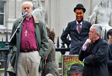 The Bishop of London, Richard Chartres, and the Dean of St Paul's, the Very Rev Graeme Knowles, address protesters. Photo: Ray Tang/Rex Features