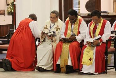 Archbishops at prayer during the Global South opening service in Singapore.