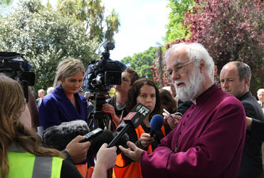 Archbishop Rowan faces the press during his tour of Christchurch's Red Zone.