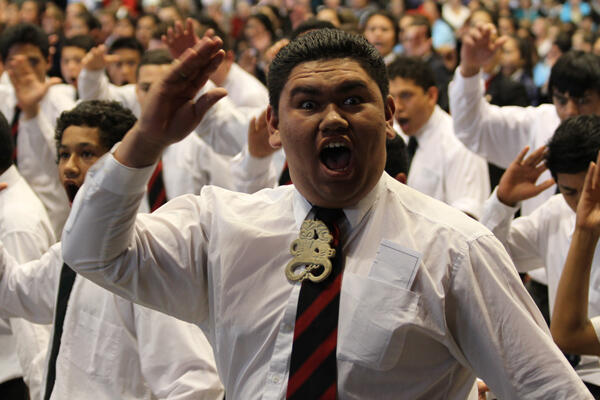 "A member of the combined schools kapa haka party gives heart and soul to ""Ka mate."""