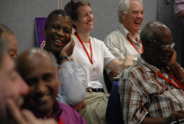 Dr Tony Fitchett (right rear), lay representative for this church, enjoys a joke at the ACC meeting in Jamaica.
