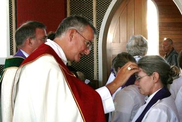 Archbishop Philip Aspinal anoints Canon Deborah Broome at Rangiatea in 2008, during the Wellington diocese 150th celebrations.