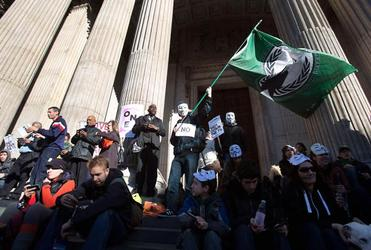 Protesters celebrate the anniversary of the Occupy movement outside St Paul's Cathedral in London. Photo: Reuters