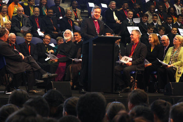 Archbishop David raises a chuckle from the Archbishop of Canterbury during the powhiri for the Anglican Consultative Council.