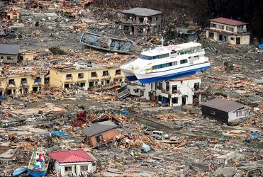 A ship is perched on top of a house in the tsunami-devastated remains of Otsuchi, Iwate prefecture. Photo: EPA