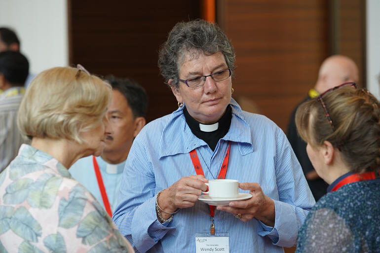 Archdeacon Wendy Scott connects with fellow ACC delegates, earlier she presided at the Pacific-led Eucharist for the ACC.
