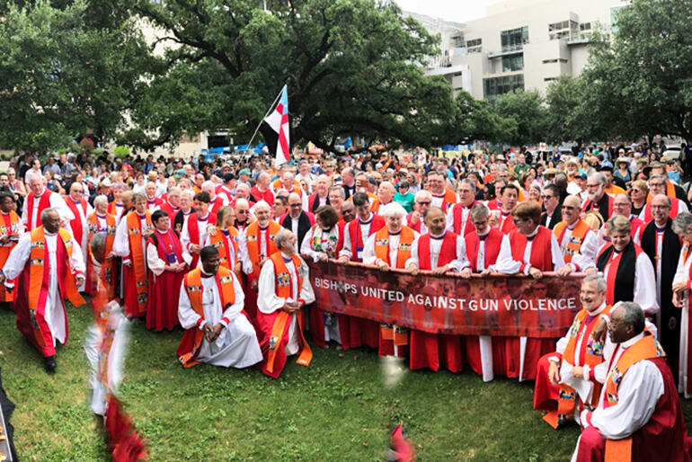 Bishops united against gun violence - in a downtown Austin park.