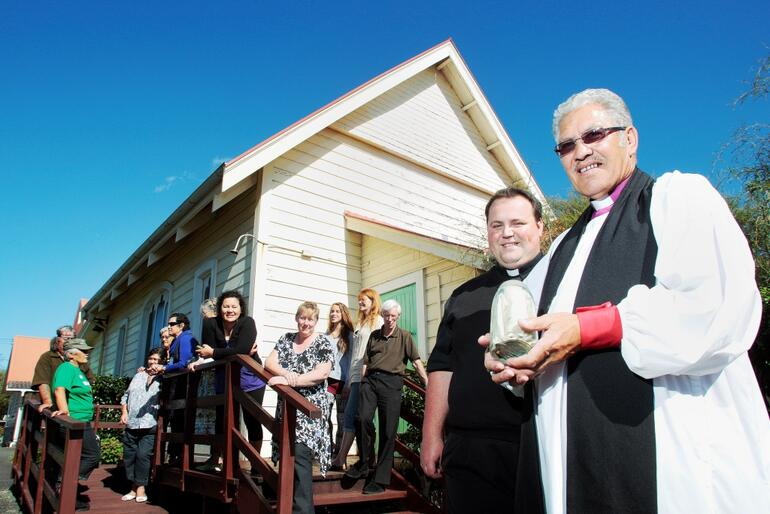 Bishop Ngarahu and Father Simmonds with the time capsule uncovered at Hemi Tapu (St James). Photo: Taranaki Herald