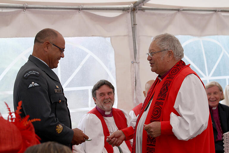 Bishop Rihari surprises Warrant Officer Peter Smith of the RNZAF.