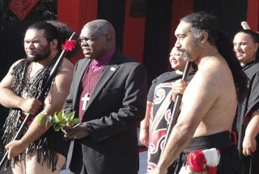 The Archbishop of York is flanked by warriors during his welcome to Te Hepara Pai.