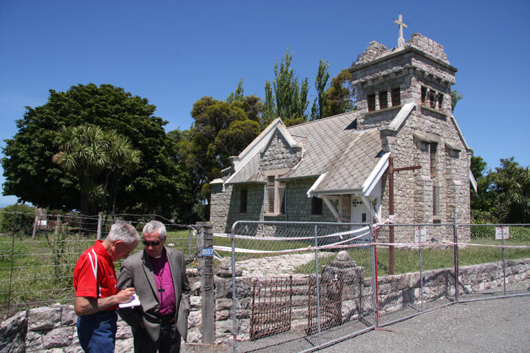 Bishop Richard and Awatere parishioner Malcolm Taylor take notes on the future of red-cordoned St Oswald's Anglican Church south of Ward.