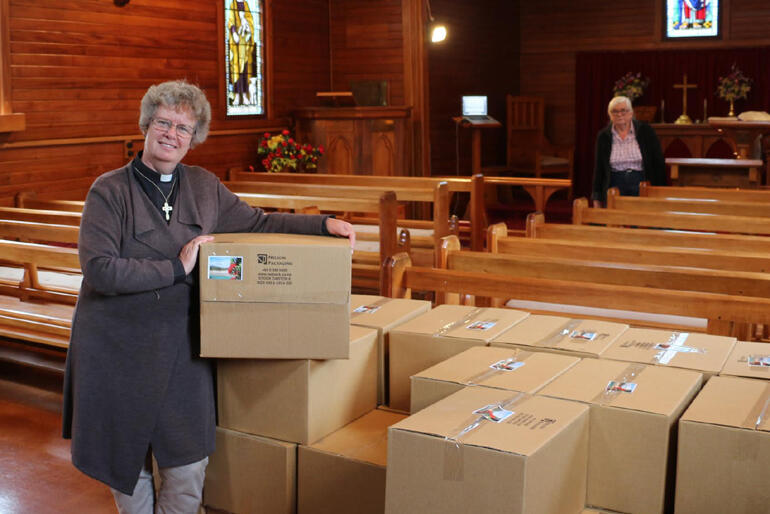 Inside St Peter's Ward: The Rev Dawn Daunauda and Catherine Gullidge ready hampers for families living in the quake-zone.
