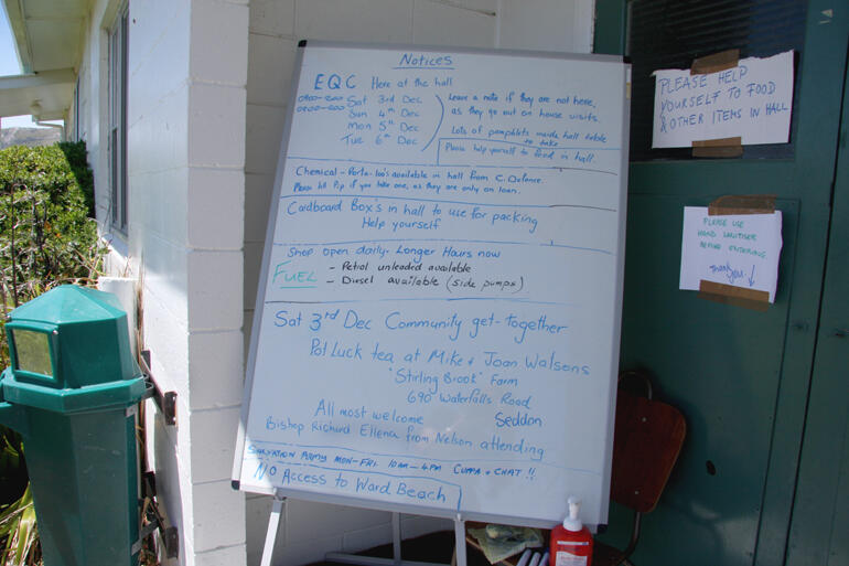 Pip Thomson's local information white board sits outside the Ward hall where Civil Defence had their emergency compound.